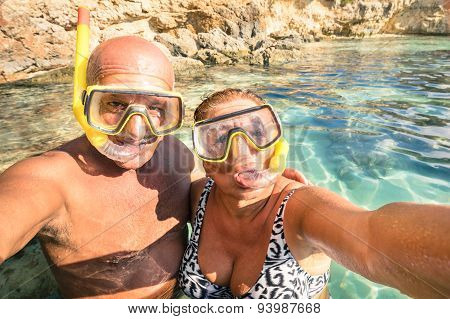 Senior Happy Couple Taking A Selfie At Blue Lagoon In Gozo And Comino - Travel To Mediterranean Sea