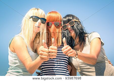 Group Of Young Girlfriends With Focus On Colored Funny Hair And Sunglasses - Concept Of Friendship