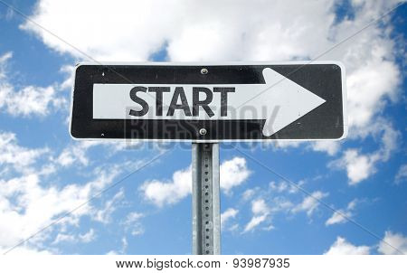 Start direction sign with sky background