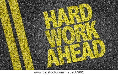 Hard Work Ahead written on the road