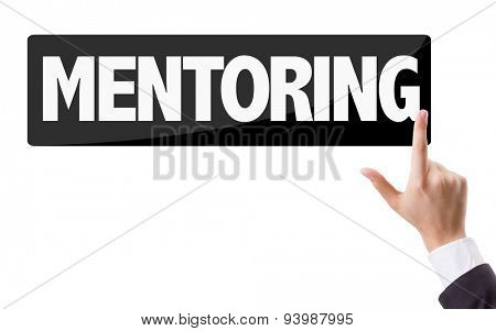 Businessman pressing button with the text: Mentoring