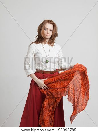 young woman in skirt dancing with a red handkerchief