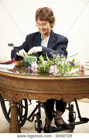 Disabled Woman Arranges Flowers
