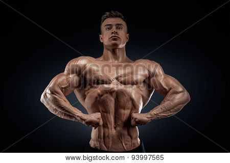 Handsome Muscular Bodybuilder Posing On Front Lat Spread