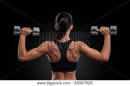 Fitness Woman In Training Muscles Of The Back With Dumbbells