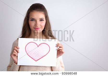 Young beautiful woman showing gift card. Valentine's Day