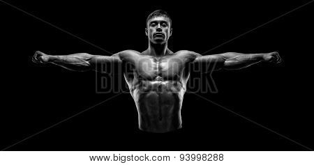 Handsome Muscular Bodybuilder Posing And Keeping Arms Outstretched.