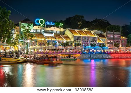 Colorful light building at night in Clarke Quay located within the Singapore River Area.