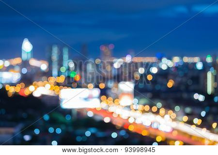 Abstract blur bokeh background of city freeway during twilight