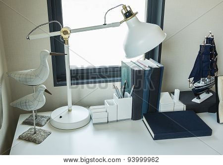 Work Table With Lamp,pencil, Book In A Home