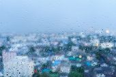 stock photo of raindrops  - raindrop on the windows with city blur in background - JPG