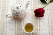 image of teapot  - fresh healthy hot tea in a teapot and cup whit rose - JPG