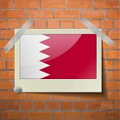 pic of bahrain  - Flags of Bahrain scotch taped to a red brick wall - JPG