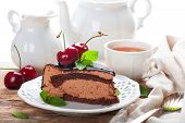 image of high calorie foods  - Slice of delicious chocolate mousse cake with cherries and mint over white - JPG