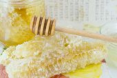 pic of decoupage  - Honeycomb dipper and lemon close up on a handmade decoupage table - JPG