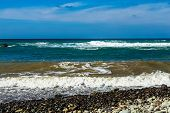 foto of atlantic ocean  - Wild stone beach on coast or shore of the Atlantic ocean with waves and sky with clouds and skyline or horizon in Tenerife Canary island Spain at spring or summer - JPG