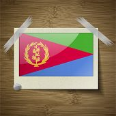 picture of eritrea  - Flags of Eritrea at frame on wooden texture - JPG