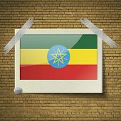 stock photo of ethiopia  - Flags of Ethiopia at frame on a brick background - JPG