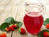 stock photo of jug  - Strawberry Juice In jug on wood background - JPG