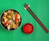 image of clam  - herbal clam soup Vietnam style served on a green background - JPG