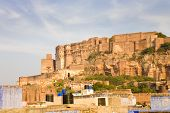 picture of rajasthani  - The Mehrangarh fortress on a hilltop in the rajasthani Blue City of Jodhpur in Rajasthan India - JPG