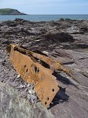 image of sloop  - Boat wreckage upon cliff seascape photographed at Polzeath in Cornwall - JPG