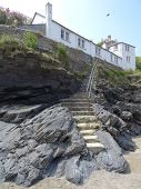 image of beach-house  - Beach cliff pathway steps leading to a house photographed at Port Isaac in Cornwall - JPG