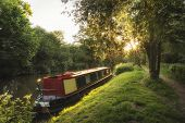 picture of barge  - Beautiful Summer sunrise landscape of barge long boat on canal - JPG