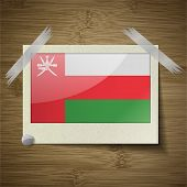 image of oman  - Flags of Oman at frame on wooden texture - JPG