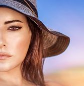 pic of arabic woman  - Closeup portrait of gorgeous beautiful arabic woman with perfect makeup wearing stylish hat on the beach - JPG