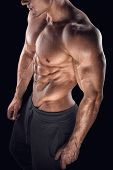 foto of abs  - Young athletic man torso showing six pack abs - JPG