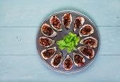 image of serving tray  - Oven baked oysters kilpatrick on special cooking and serving metal tray - JPG