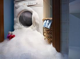 stock photo of washing machine  - soap coming out from broken washing machine - JPG