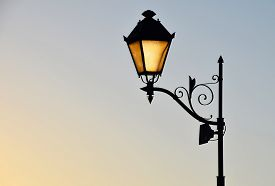 picture of lamp post  - Street antique style lamp post with effect of shine from low light of sunset - JPG