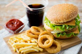 stock photo of coca-cola  - fast food and unhealthy eating concept  - JPG