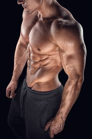 stock photo of bicep  - Young athletic man torso showing six pack abs - JPG
