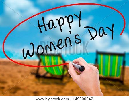 Man Hand Writing Happy Women's Day With Black Marker On Visual Screen