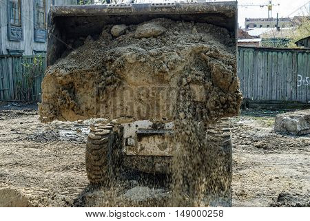 Tyumen, Russia - May 5, 2007: skid loader working on road construction site