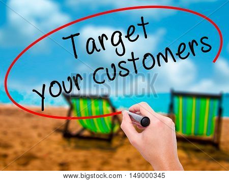 Man Hand Writing Target Your Customers With Black Marker On Visual Screen