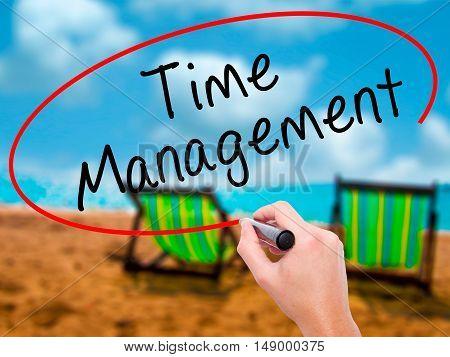 Man Hand Writing Time Management With Black Marker On Visual Screen