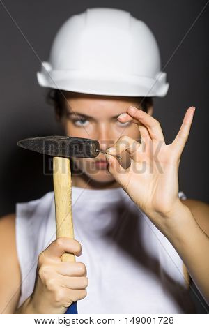 Girl Repairer With Hammer