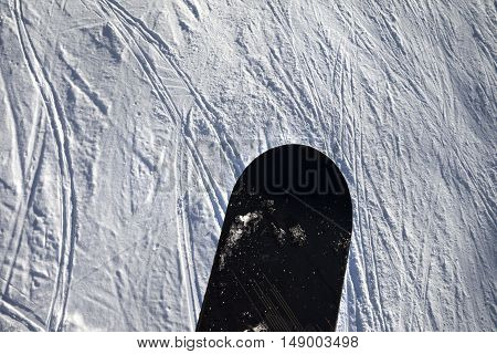 Snowboard Over Off-piste Slope With Track From Ski And Snowboard On Sun Winter Day