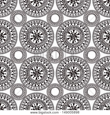 Seamless pattern boho style monochrome vector illustration. the circular pattern is drawn by hand.