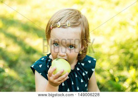 Cute Baby Girl Eats Apple