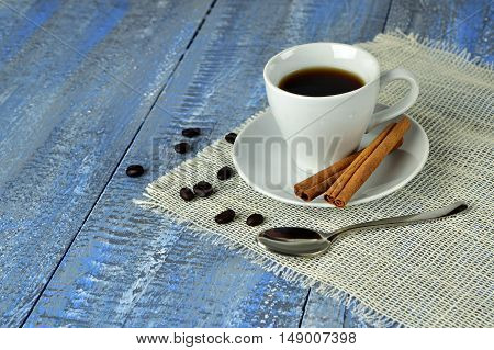 A cup of coffee with cinnamon and coffee beans.  Morning Life style.Close-up. selected focus