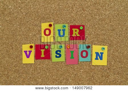 Our vision written on colorful notes pinned on cork board.