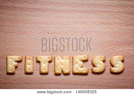 folded letter in the word of cookies on wooden background