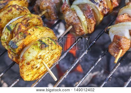 Close Up Picture Of A Zucchini And Meat Skewers.