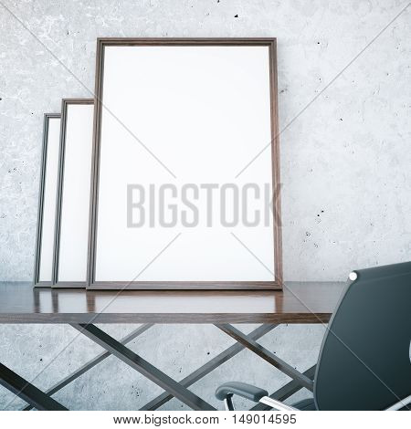 Three blank picture frames placed on dark wooden table on textured concrete background. Mock up 3D Rendering