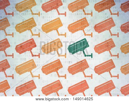 Security concept: rows of Painted orange cctv camera icons around green cctv camera icon on Digital Data Paper background